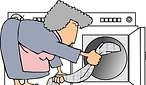 6019-Housewife-Putting-Wet-Clothes-Into-A-Dryer-Clipart-Picture
